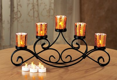 Beautiful iron candle holder perfect for a dining table for Candle centerpieces for dining tables