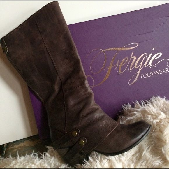 FERGIE BOOTS FERGIE DISTRESSED BROWN LEATHER BOOTS STACKED HEELGREAT LOOKING & COMFORTABLE  DOUBLE BELT WITH BRASS BUTTON ON SIDE SHOULD FIT A WIDE CALF GENTLY LOVED WORN ONLY A HANDFUL OF X'S IN EXCELLENT CONDITION COMES WITH ORIGINAL BOX (if you want it) Fergie Shoes Heeled Boots
