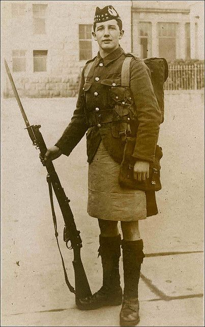 Postcard photo of a WWI Scottish Regiment soldier no doubt taken for his family. Thousands of such photos were produced but regrettably few bear any identification. He is wearing a cover over the kilt.