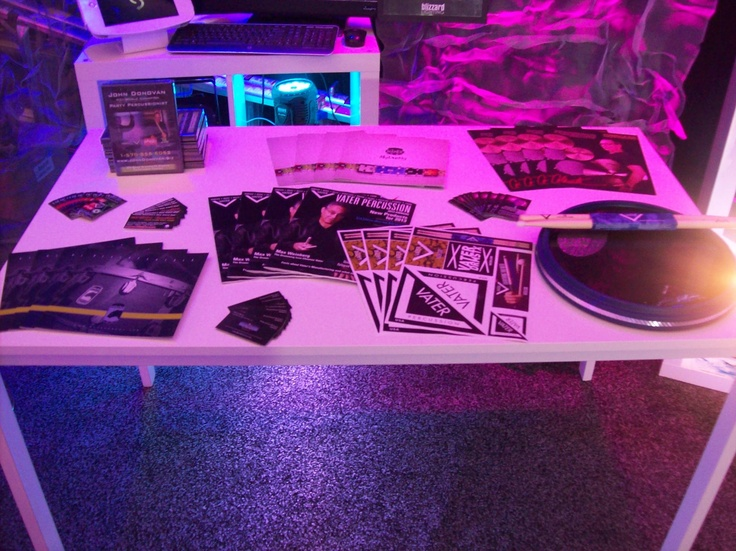 John's marketing table at The Blizzard Lighting, LLC's booth at The NAMM Show - 2013 — with Paiste Cymbals, John Party-Percussionist Donovan, EA Kroll Productions and OffWorld Percussion at Anaheim Convention Center.  Tags: Mapex USA, Negb1Radio, Blizzard Lighting, LLC, Mapex Drums and Vater sticks