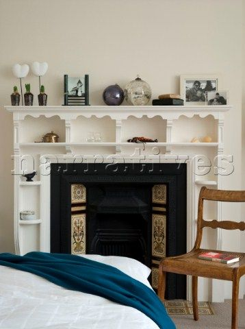 Edwardian fireplace with decorative shelves and tiles