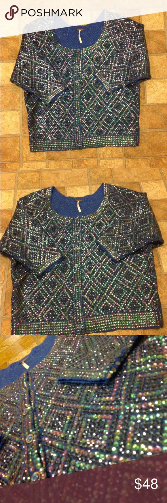 Free People Bedazzled Sequined Cardigan NWOT This blue purple and green bedazzled sequined cardigan from Free People is Siri gypsy chic. It is new without tags. The material is made out of 70% acrylic and 30% wool. The measurements are sleeve 18 inches length 20 inches bus 19.5 inches. Free People Sweaters Cardigans