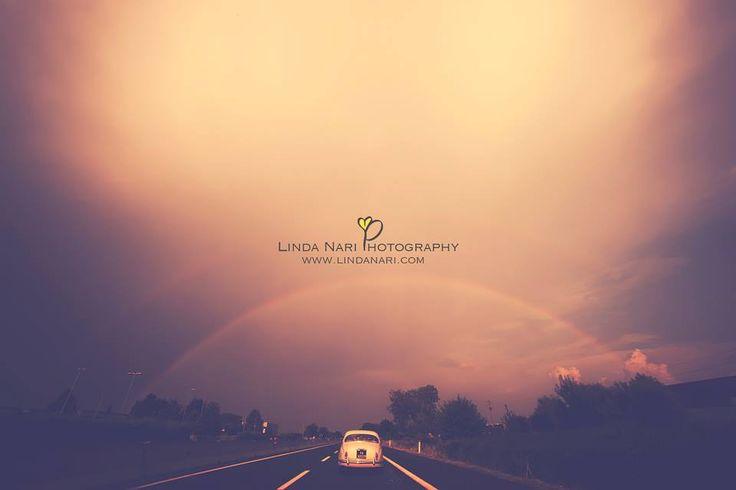 wedding car rainy rainbow