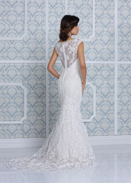 lace gown with buttons down the back by Impression Bridal #weddingdress #bride #weddingchicks http://www.weddingchicks.com/2014/03/11/impression-bridal-wedding-gowns/