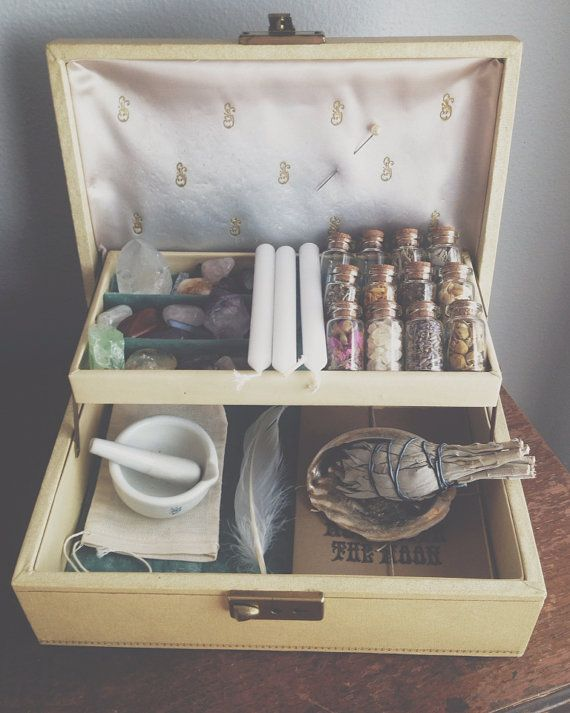 The Witch's Charm Box by MoveWithTheMoon on Etsy -- this is awesome! I made mine out of an old wooden European sewing box with hinged drawers that opened out on both sides like this center drawer does.