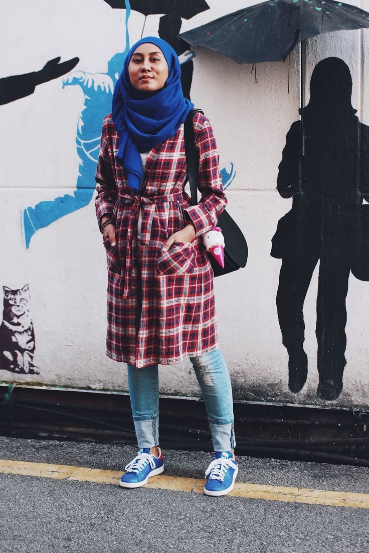 Tied plaid robe with ripped jeans and polka dot Adidas Pharrell sneakers