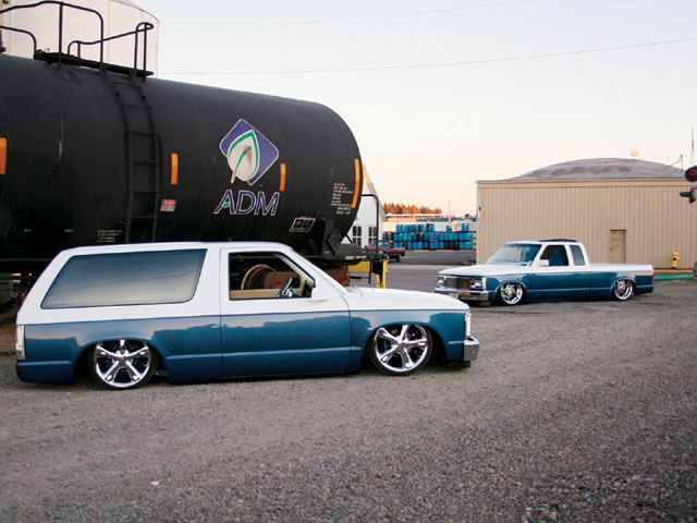 Read about Michael Amborn's custom 1983 Chevy S10 Blazer and matching Chevy S10 truck, both body dropped, and air bagged with two tone paint, at Mini Truckin' Magazine.