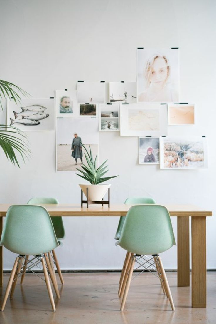 Dining chairs of Eames chairs in mint green                              …