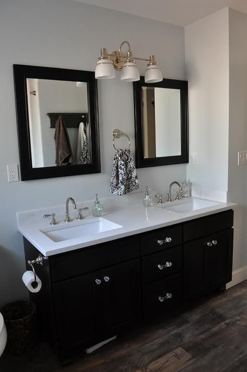 double sink vanity with clean white quartz countertop with beautiful vinyl faux wood flooring