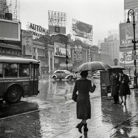 "Rainy Day People March 1943. ""New York, New York. Times Square on a rainy day."""