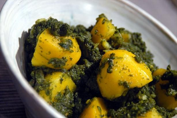 Aloo Palak (Indian Potatoes & Spinach) from Food.com: I got this aloo palak recipe from daawat.com, but have adjusted it slightly to my liking. It will serve two as a main course when served with naan bread or rice, or four as a side dish. If you like it a little milder deseed the chilies.