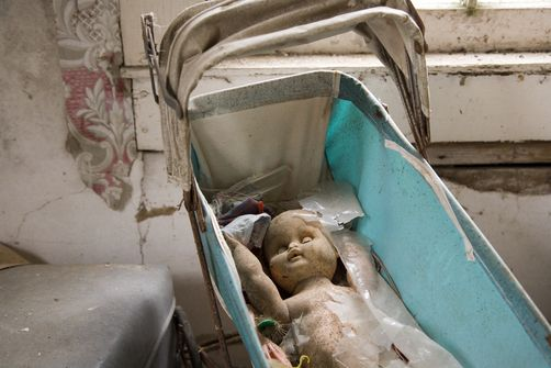 Moldy baby doll, carriage in abandoned house on Chesapeake Bay. Location:	Crocheron, Maryland, Chesapeake Bay United States, North America