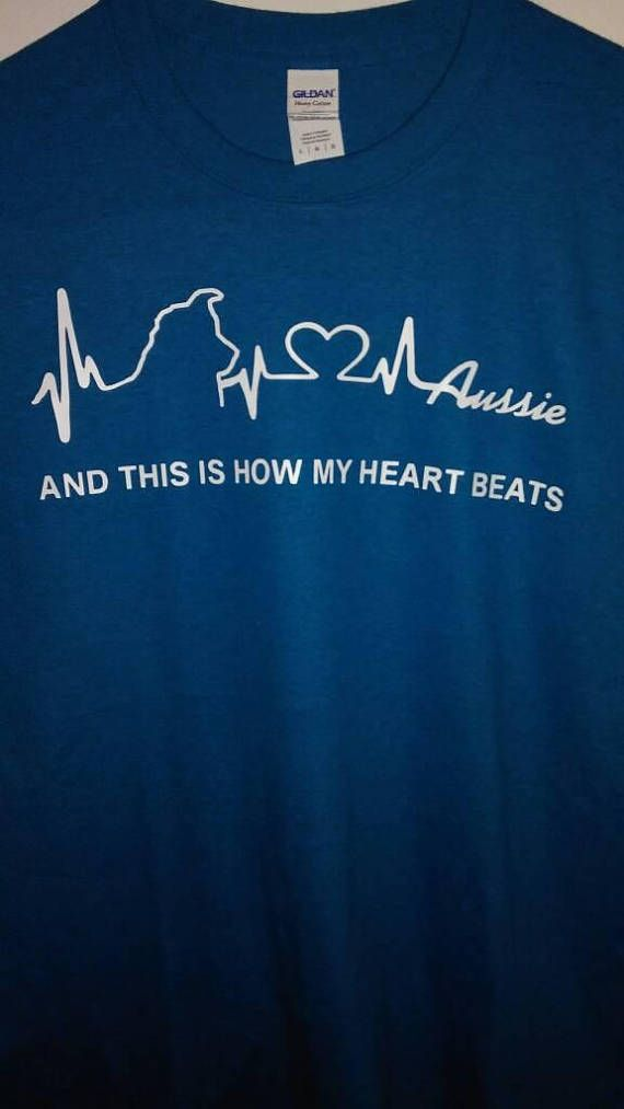 For the dedicated Aussie lover - This Is How My Heart Beats shown with white print on a heather grey T, it really stands out! Soft and supple these shirts offer the ideal fit.    Printed on a high quality Gildan T-shirt.   100% preshrunk cotton blend; Seamless rib at neck; Taped shoulder-to-shoulder; Double-needle stitching throughout.    The first color swatch shows Cherry Red, Dark Heather Grey and Blackberry  The second color swatch shows Antique Sapphire, Midnight and Heather Red…