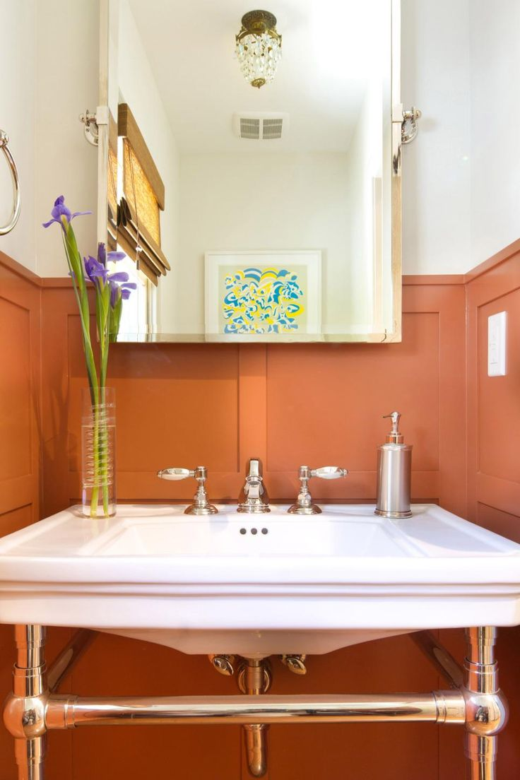 Bold Orange Wainscoting Creates Instant Character In This Small Bathroom.  An Open Vanity And White