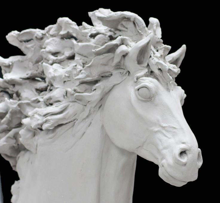 Clay horse sculpture