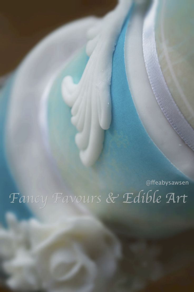 Sky blue mini tiered cake with white bas relief detail shot | Fancy Favours & Edible Art -- #vintage #skyblue #blue #basrelief #roses #white #elegant #cake #occasion #vintage #ornate #baroque #rococo #flowers #customcake #mini #tiered #tall #wedding #weddingcake