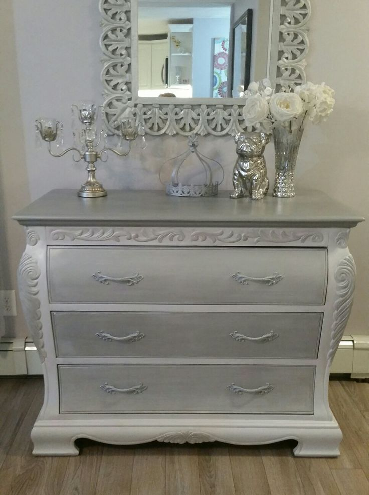 Full view of the repurposed Bombay Dresser. I refinished this in gray, silver, metallic, white, distressed and finished with new French style knobs. https://m.facebook.com/ChicandShabbyFurnitureByRebecca/