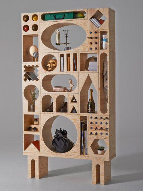 Room shelving system functions like a huge shape-sorter toy.