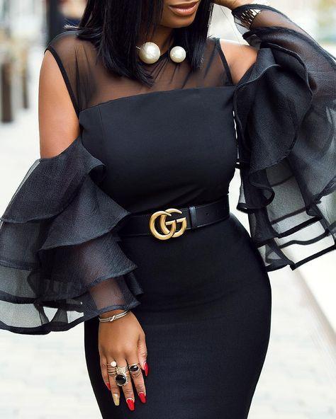 Is a beauty of elegant dress so let's just look at those sleeves - es una hermosura de vestido elegante tan sólo miremos esas mangas