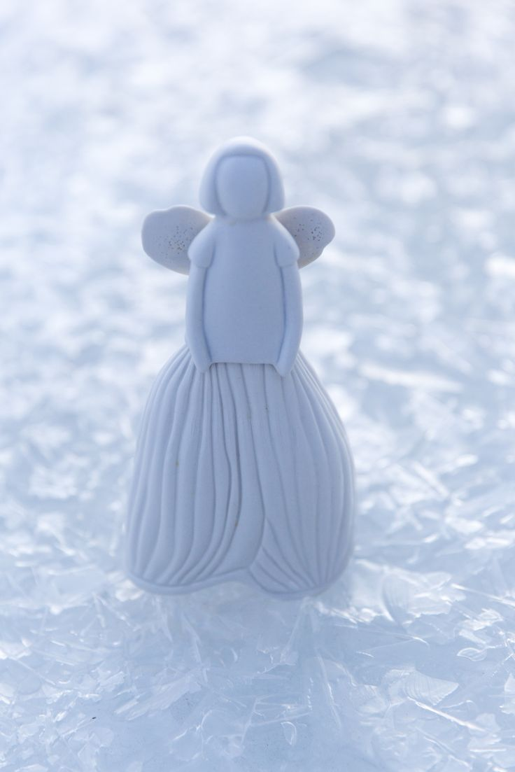 Pentik Lumikello Angel Decoration | Lumikello Enkeli (Snowdrop Angel) belongs to magnificent Studio ceramics designed by Anu Pentik. The idea of Pentik Studio collection is to bring hand-made and durable ceramic art to homes. Made in Posio, Lapland, Finland.