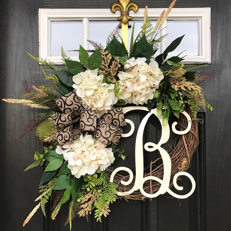 This gorgeous everyday wreath is so fresh and perfect for anytime of year! Add a monogram to personalize this beauty!
