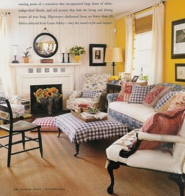 """""""Checks and patterns, red and white fabrics add to the mix livening the cool blues and complementing the yellow walls."""""""