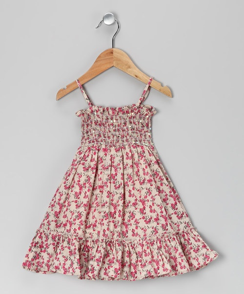 This airy frock is the perfect outfit for an afternoon tea party. In addition to a sweetly smocked bodice, it features lettuce-edge trim, a ruffle hem and sequins sprinkled in the bodice.100% cottonMachine wash; tumble dryMade in India
