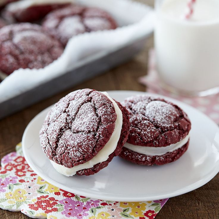You love red velvet cake – well now you can have the taste you love in cookie form! These Red Velvet Sandwich Cookies are made using a cake mix, so they're fluffy and soft. Sandwich two of these cookies together with a sweet cream cheese filling and you've got a new favorite cookie to make come Christmas or Valentine's Day!