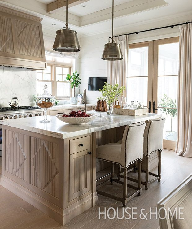 A coffered ceiling visually expands this entertaining-ready kitchen, the showpiece of an elegant country manor in Knowlton, Que. | Design: Scott Yetman Photo: André Rider