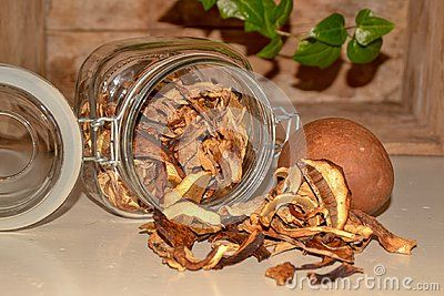 A glass Jar with Delicious dry mushroom boletus Food ingrediens still life wooden background