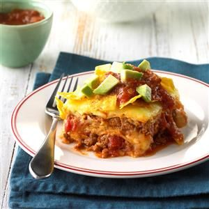 Texas-Style Lasagna Recipe -With its spicy flavor, this dish is a real crowd-pleaser. It goes great with side servings of picante sauce, guacamole and tortilla chips.— Effie Gish, Fort Worth, Texas