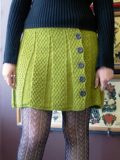 I am SO going to knit this skirt for myself (in a different color, for next winter, after I hit my 150 x 50 birthday goal). Patter by Nikol Lohr on Knitty.com