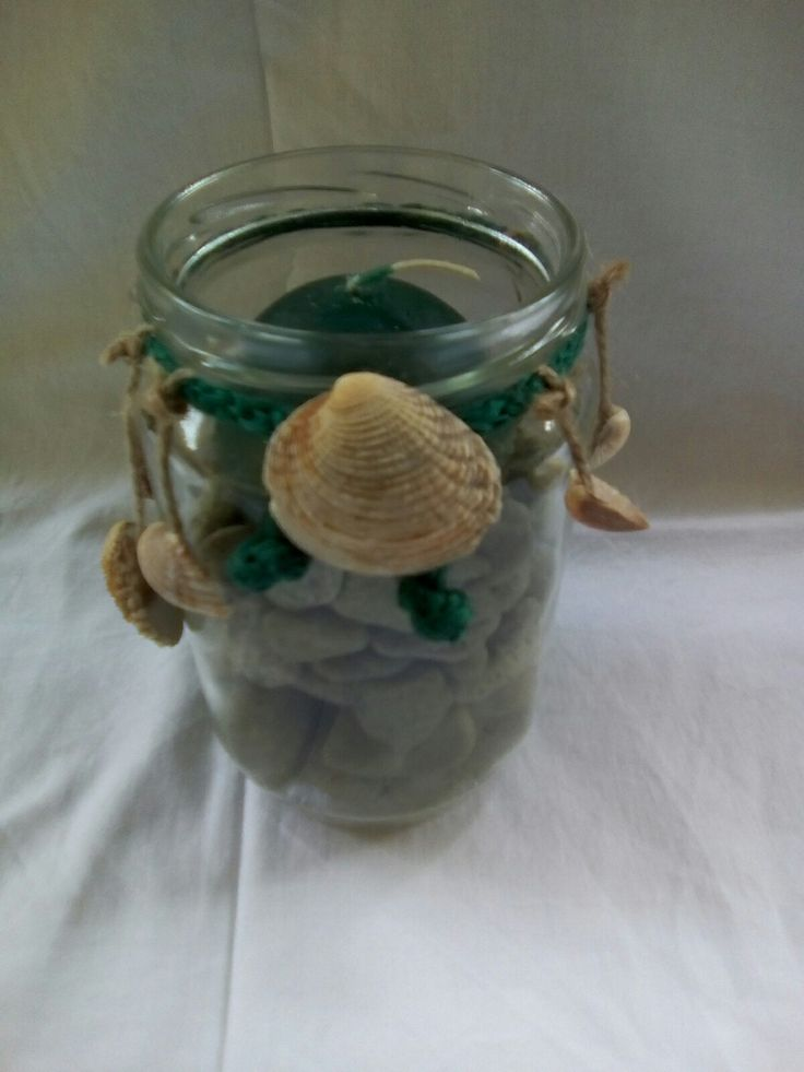 Jar full with green sea rocks and summer decoration