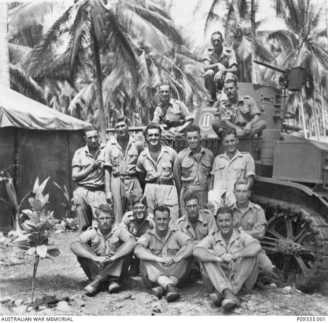 Outdoor group portrait of members of the 2/6 Armoured Regiment.  Front row, from left:  Trooper (Tpr) Eric Elder; NX48683 Maxwell Brennan Lenehan; Tpr Albert (surname unknown). Second row, from ...
