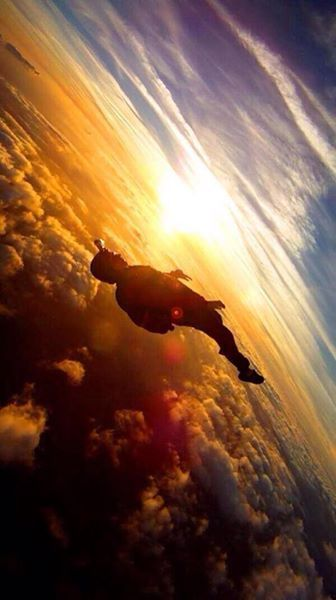 Skydiving during sunset