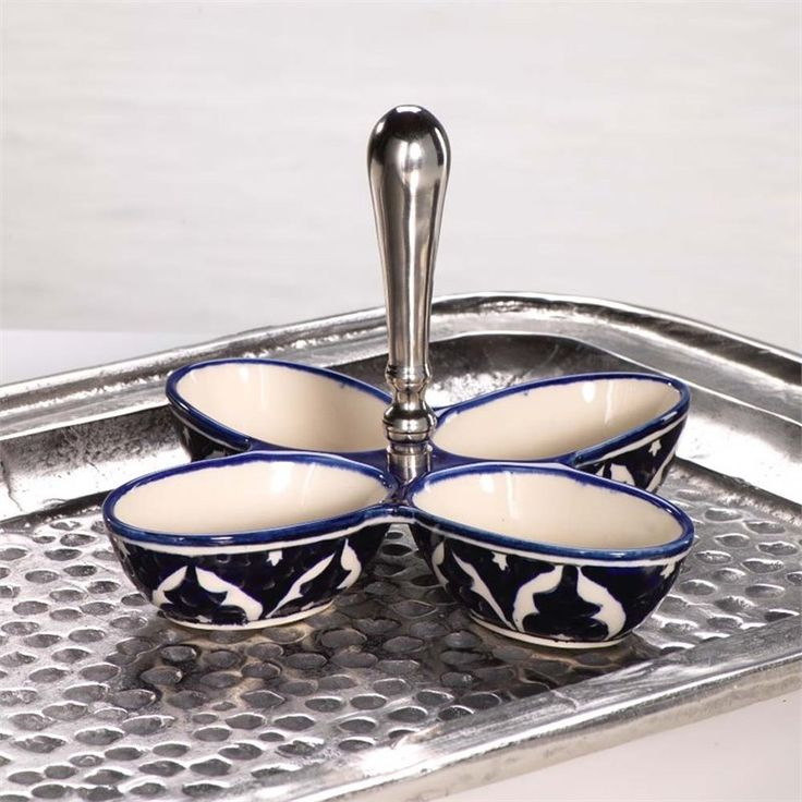 Beautifully hand-painted, 4 pieces. We love the crispness & charm of this blue and white condiment set. Mix and match with other pieces from this collection or with any white and blue pieces to add a touch of the Mediterranean.