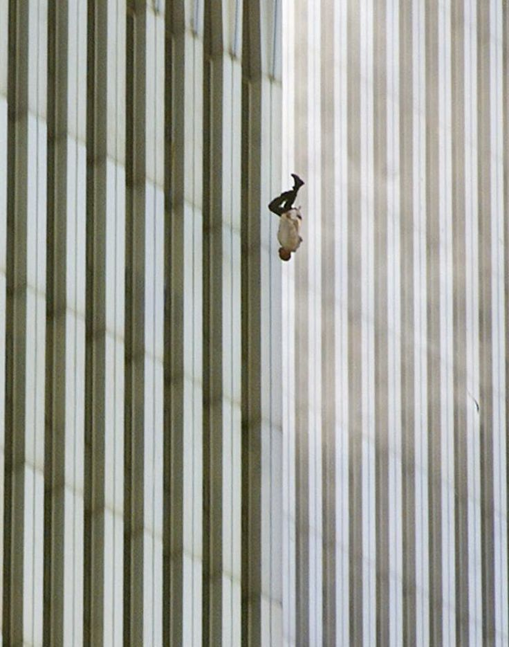 """9/11 picture: a victim falling from the World Trade Center's north tower""""Falling Man"""" This famous photograph, known as """"Falling Man,"""" captures the plunge of an unknown victim of 9/11 from the north tower—one of many who jumped or fell to their deaths from the upper floors of the World Trade Center.  PHOTOGRAPH BY RICHARD DREW, AP"""