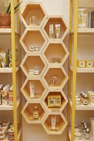 London, UK Burts Bees Hive Pop-Up Store merchandising display. This honey comb shelving is great-- especially for a Burts Bees product or  any sort of honey!