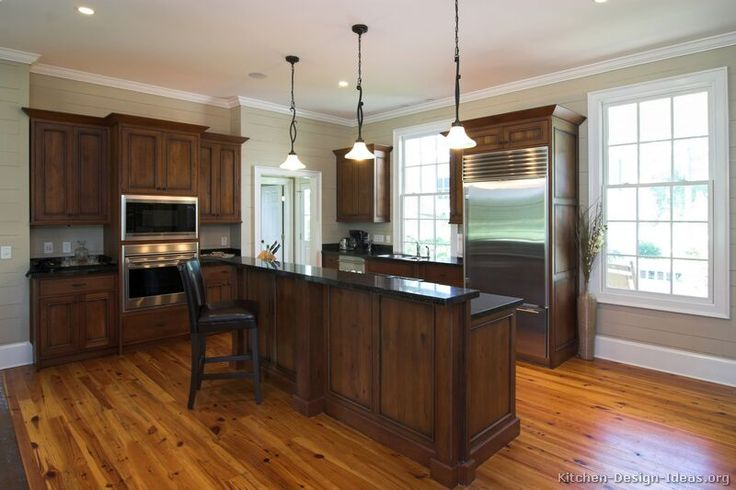 Google Image Result for http://www.kitchen-design-ideas.org/images/kitchen-cabinets-traditional-dark-wood-walnut-color-032-s3712015-bi-level-island-wood-floor.jpg