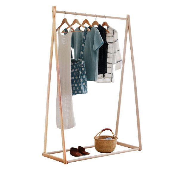 a gorgeous natural clothes rack perfect for showcasing your cherished pieces that are too good