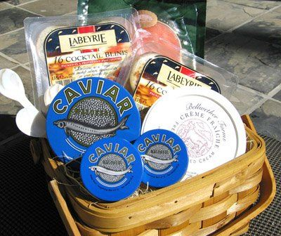 Includes 9oz. tin of Russian Ossetra, 2oz. Russian Imperial Ossetra and Sevruga Caviar. Three Pearl Spoons, Two Package of Blinis, 7.5oz. of Creme Fraiche. 8oz. Smoked Salmon, Greeting Card with a Personalized Message. Deluxe Russian Caviar Gift Basket