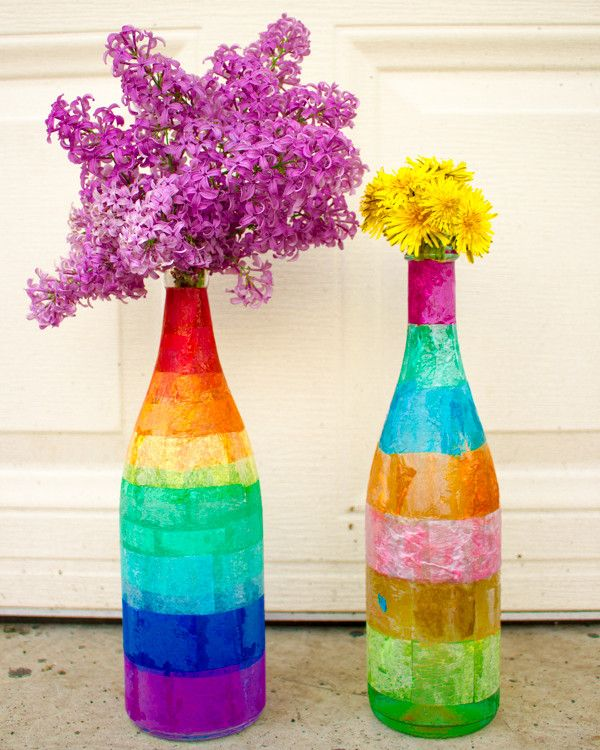 Tissue Paper Decoupaged Glass Bottles - Decoupaging glass bottles is a cheap, easy way to upcycle something plain and ordinary into something unusual and outstanding.