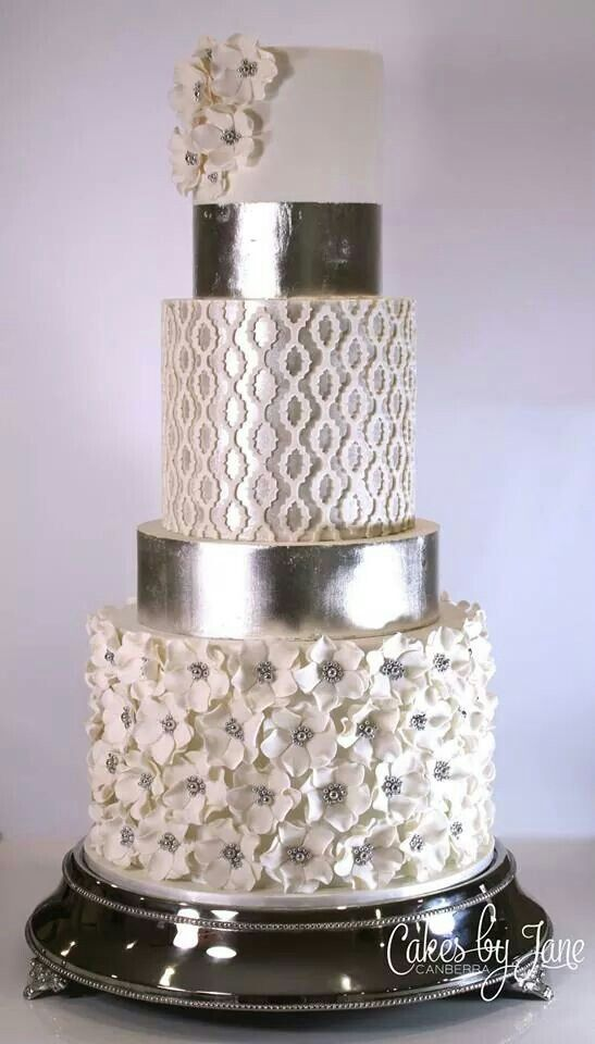 Very elegant five tier silver wedding cake with several textures.