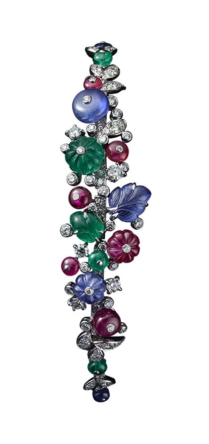 Cartier High Jewelry bracelet Platinum, sapphire, ruby and emerald beads, sapphire and emerald carved leaves, brilliants.