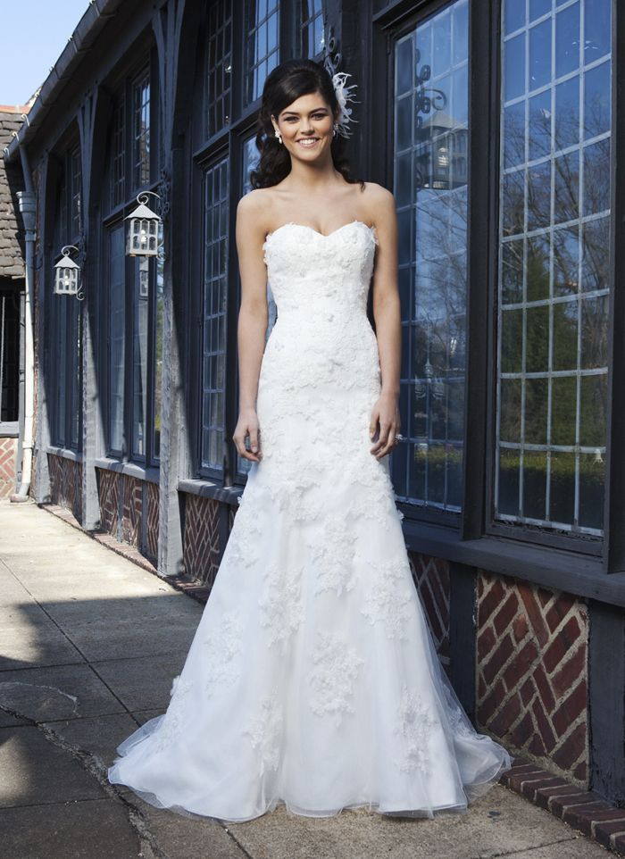 Sincerity wedding dress style 3731 A mermaid gown with a sweetheart neckline in point d'esprit with lace  appliqués and three dimensional flowers. Buttons cover the back zipper  and this style has a chapel length train.