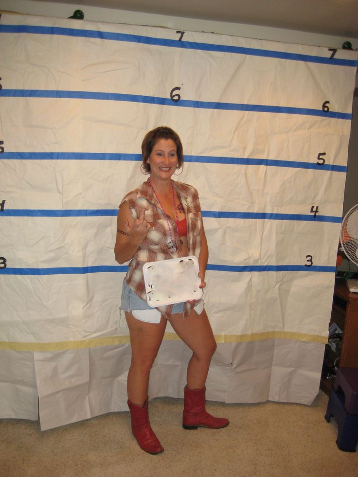 White Trash Party - set up a mug shot photo booth for your guests.... We would make this a lot better