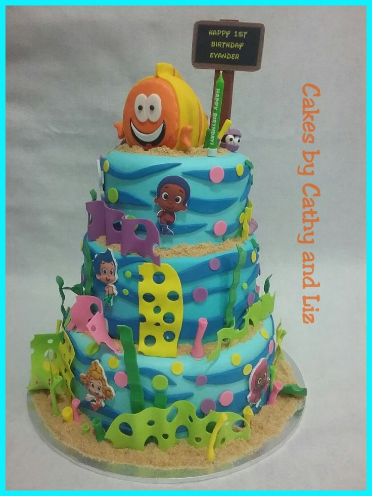 Bubble guppies inspired first birthday cake