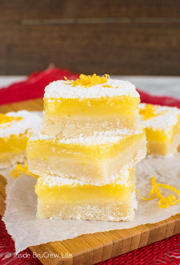 The Best Lemon Bars recipe - a sweet shortbread cookie crust gives a fun sweet twist to the tradition dessert bars.