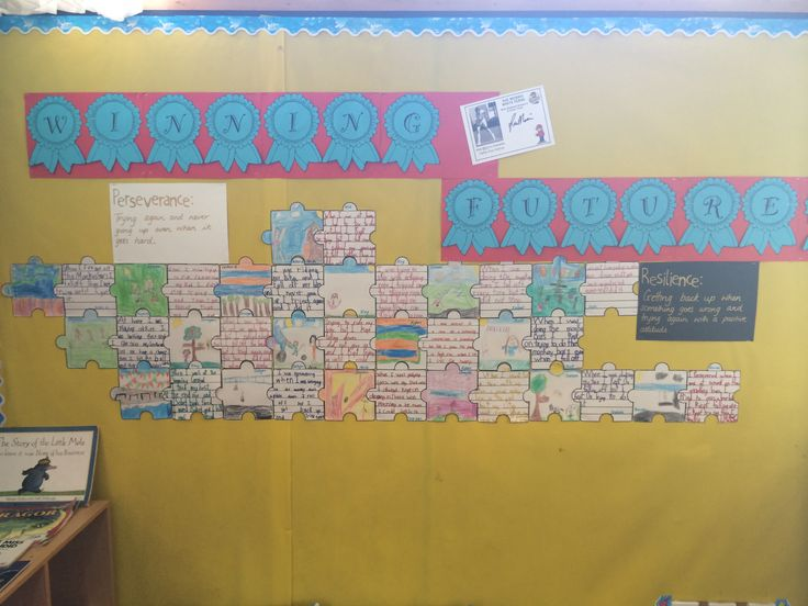 """Writing about being resilient and persevering - published onto puzzle pieces and then displayed under our """"winning futures"""" title"""