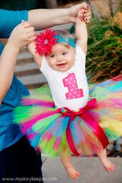 a colorful and stylish tutu for a little girl's first birthday party outfit